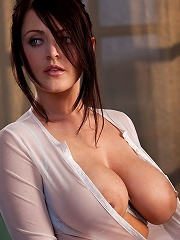 Sophie Dee takes off her light blue top